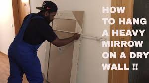 Hanging Pictures On Drywall by How To Hang A Heavy Mirrow Dry Wall Youtube