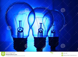 row of light bulbs on a bright blue background royalty free stock