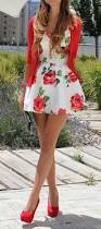 fun floral print dress matched with strawberry sweater and heels