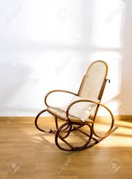 golden retro rocker wooden swing chair on wood floor as a vintage
