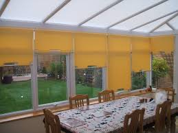 roller blinds in conservatory u0026 shaped bottoms with chrome poles