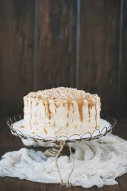 chocolate toffee caramel crunch cake with peanut butter meringue