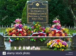 french war memorial with flowers on november 11th remembrance day
