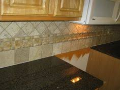 tile backsplash kitchen ideas this is an slate tile backsplash with some great pattern