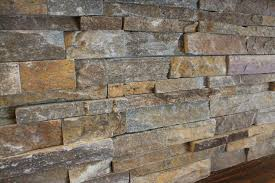 stacked ledger stone fireplace seaspray tile and ceramics