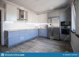 modern white kitchen cabinets wood floor blue and white cabinets in modern kitchen interior stock