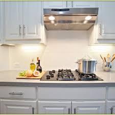 white kitchen white backsplash kitchen white glass tile backsplash design with wooden flooring