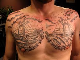 mens chest with colorful bird and quote chest tattoos for