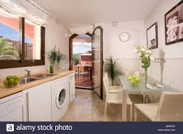 Small Galley Kitchens Glass Table And Beige Chirs In Small Galley Kitchen Diner In