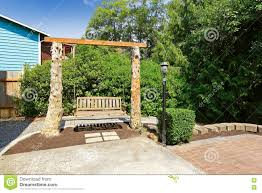 wooden swing bench outside in the back yard stock photo image