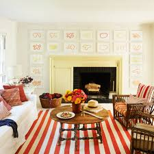 home design living room decor 20 ways to decorate with orange and yellow coastal living
