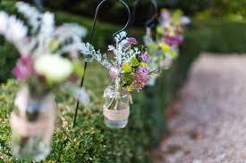 wedding flowers jam jars grace bramble shepherd hooks and hanging jam jars wedding