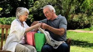 Bench Couple Shirt - seniors savouring park hd stock video 303 779 059