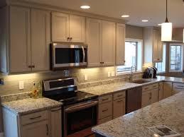 sand dollar cabinet knobs kitchen homecrest cabinetry lautner maple sand dollar with