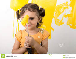 Painting Home by Little Feeling Happy While Painting Home Wall Stock Photo