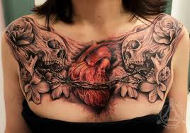 chest piece with skulls and wire heart tattoos pinterest