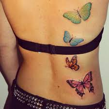 colored butterflies tattoos on back