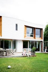 a weatherboard extension transforms a 50s brick house