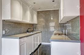 Kitchen Cabinets Trim White Kitchen Cabinets With Grey Tile Wall Trim And Tile Floor