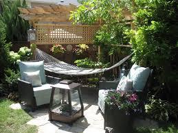 small backyard with string lights and hammock hang a hammock in