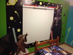 solar system bedroom theme using black chalkboard paint and wall star wars themed bedroom behr paint in appletini green space black and whiteboard paint decorated with darth vader and yoda cutouts from the movie