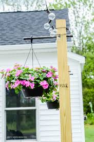 outdoor string lights on diy posts simply kierste design co