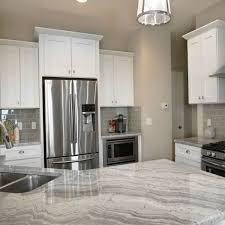 kitchen room cream wooden kitchen island black marble counter