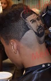 obsessed drake fan draws the rapper u0027s tattoo on his head photos
