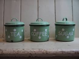 set of vintage enamel kitchen canisters pastel green polka dot