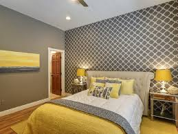 yellow and grey wall decor white chest white sofa black leather bedroom yellow and grey wall decor white chest sofa black leather bed there purple pillow