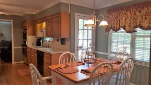 kitchen wall paint color to complement medium stained maple cabinets