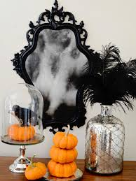 How To Make Halloween Decorations At Home by How To Make A Ghostly Antiqued Mirror Hgtv