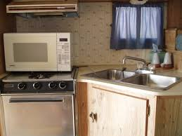 Kitchen Queen Wood Stove by 1988 Sunlite Hide Away Camper Pictures