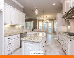 white kitchen cabinets with light grey backsplash white cabinets light grey countertop and pics of white