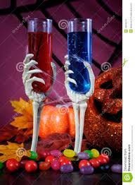 happy halloween ghoulish party cocktail drinks with skeleton