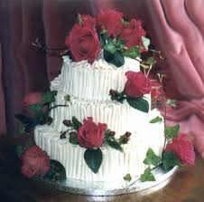 cake white chocolate with red roses and green leaves all fresh