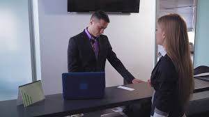 bank worker giving credit card to new client blonde woman holding