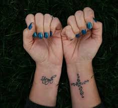 cross on side of wrist tattoo play with fashion