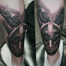 calf tattoo bird and fighters ideas tattoo designs