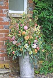milk churn pedestal arrangement rustic boho country garden