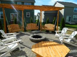 apple valley fire pit with pergola swings devine design hardscapes