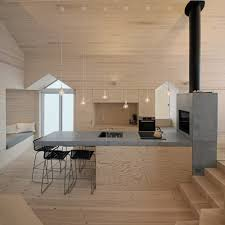 minimalist polished concrete and wood kitchen and breakfast bar in