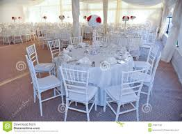 event tables and chairs tables set for an event party or wedding reception stock photo