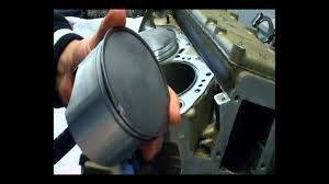 how to install outboard pistons when rebuilding your outboards