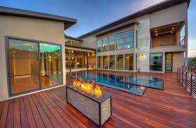 swimming pool wooden swimming pool deck of luxury house backyard