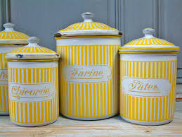 enamel kitchen canisters vintage enamel kitchen canister set in yellow by chanteduc