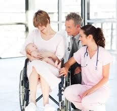 Doctor And Nurse Mother With Her Newborn Baby Doctor And Nurse U2014 Stock Photo