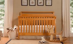 honey oak cribs davinci baby nursery with green walls and oak