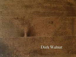 dark cherry walnut kitchen cabinets with grey wood floors wood