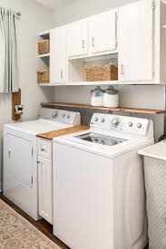 best place to buy cabinets for laundry room this 300 laundry room makeover will make your jaw drop